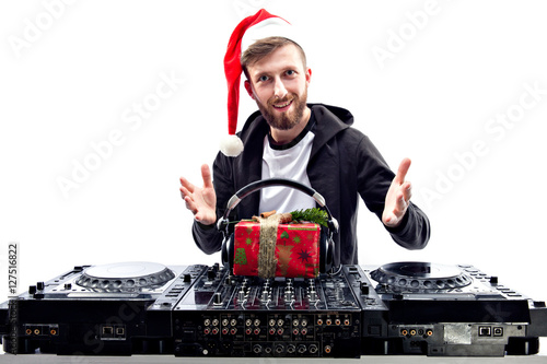 Poster Happy Dj put headphones on gift box. Horizontal indoors shot