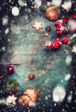 Christmas background with fir branches, cookies , gingerbreads and snow, top view frame, vertical