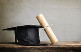 graduation cap, hat with degree paper on wood table Empty ready