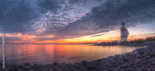 Foto op Canvas Zee zonsondergang Panoramic view of beautiful sunset with scarlet clouds above the Gulf of Finland.