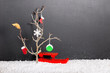 bare tree with leaf, mittens, boot, snowflake, Christmas ball an
