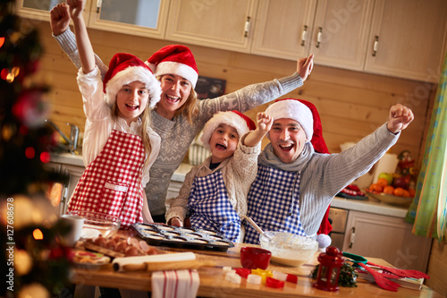 Poster happy family baking cookies on Christmas.