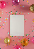 Mockup card on a pink background with their Christmas decorations and confetti. Invitation, card, paper. Place for text