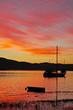 Sud Africa, 27/09/2009: barche e tramonto mozzafiato a Thesen Islands, un insediamento portuale sorto sull'estuario della città di Knysna, sulla Garden Route