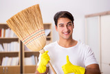Man husband cleaning home in family concept
