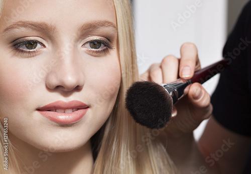 Poster beautiful blonde girl and makeup artist, makeup