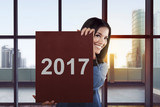 Asian business woman say happy new year 2017
