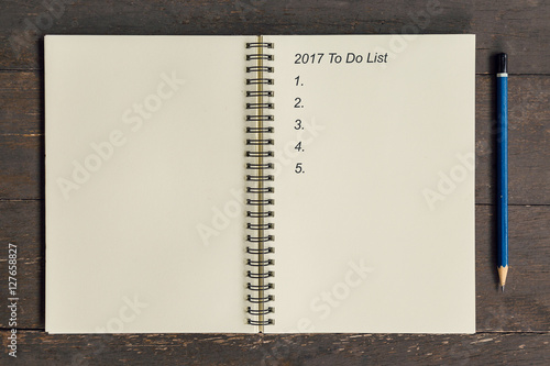 Poster Business concept - Top view notebook writing 2017 To Do List.