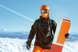 Snowboarder snowboard portrait mountain top