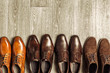 Fashion concept with male shoes on wooden background