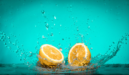 Lemon Slices falling for water with a big splash on blue backgro