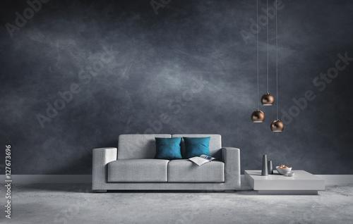 Sofa vor blaugrauer Wand mit Struktur