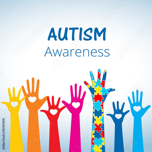 Autism awareness concept with hand of puzzle pieces as symbol of autism.