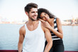 Happy tender multiethnic young couple in harbour