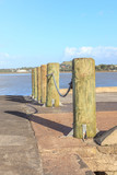 Row of wooden poles at the pier for security walkway.
