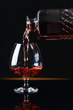 Glass of brandy on a black background