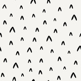 Abstract seamless pattern in black on cream background.