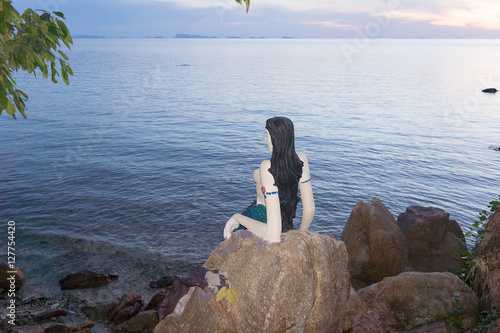 Little Maermaid sits on a cliff in the sunset Poster