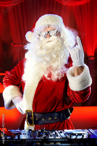 Poster Dj Santa Claus at Christmas with glasses and snow mix on New Yea