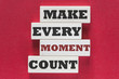 Make every moment count. Motivational quote written on wooden tiles