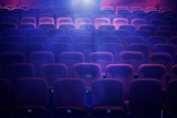 Empty movie theater with projection light falling into the lens - 127790044