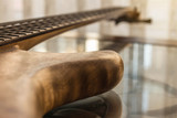 part of electric bass guitar in natural light