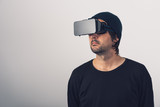 Male actor in virtual reality environment wearing vr goggles