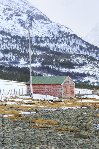 Poster Red Rorbu Fishing Huts on Ullsfjord shoreline near Svensby, Troms county, Norway