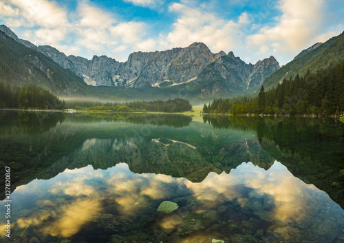 Poster Oceanië autumn over alpine lake in the Julian Alps, Italy