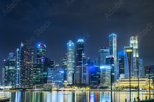 Poster abstract night cityscape of waterfront in singapore - can use to display or mont