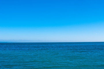 Fototapeta spokojne morze i niebieskie niebo