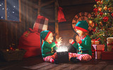 happy children brother and sister elf, helper of Santa with Chri