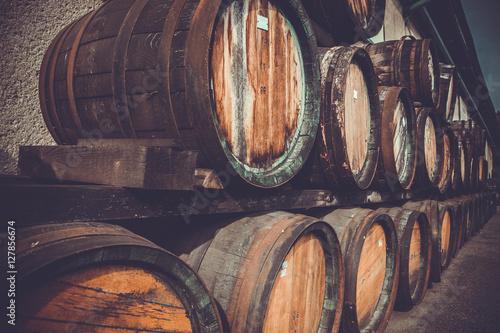 wooden barrels in the distillery folded in the yard in shelves © edojob