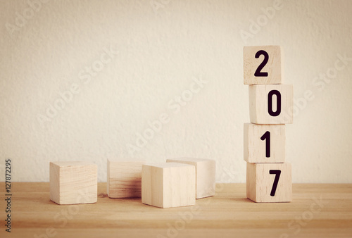 Wooden cubes with 2017 on wooden table background Poster