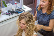 Young woman in chair at barbers and hairdresser.