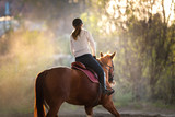 Young girl riding a horse - 127900482