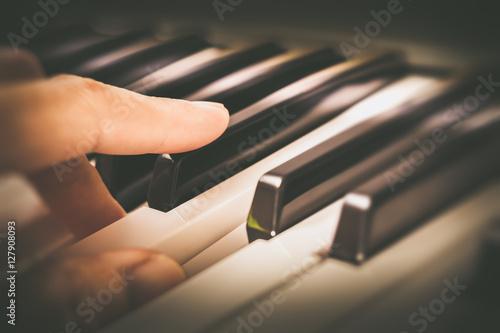 Fototapeta male musician fingers playing on piano keys