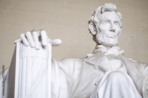 Statue of American president Abraham Lincoln seated in white marble at the Linco Poster