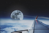 View through aircraft window. traveling by plane with beautiful aerial sky with full moon and stars at night - 127912667