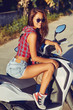 Young girl on a motorbike outdoor portrait