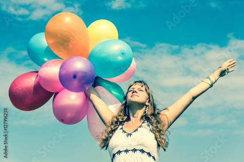 Poster Girl playing with colorful balloons