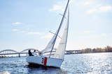 Sailing man on sailboat during regatta. Competition day