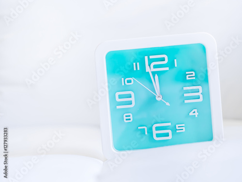 Clock and gentle fabrics background Poster