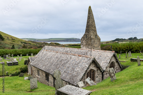 Poster The Church of St Enodoc is located amongst sand dunes adjacent to the Cornish village of Trebetherick