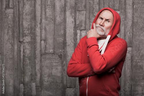 Poster emotional closeup of Santa like man face in sportswear in studio