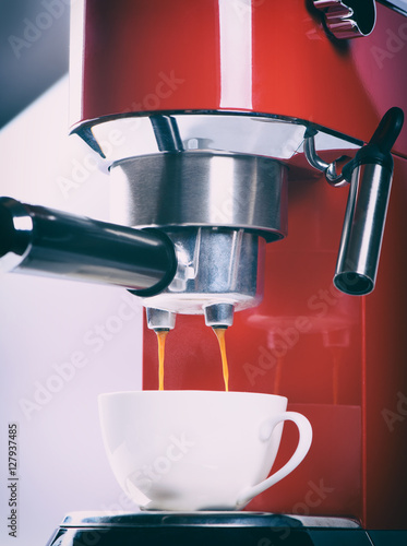 Poster red espresso coffee machine is making a coffee