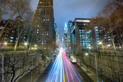Foto op Plexiglas New York TAXI Night cars traffic in big city, long exposure