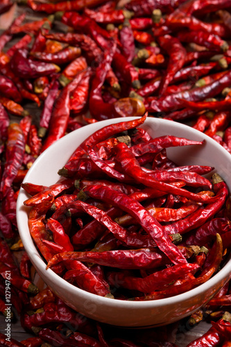 Poster Red hot chili pepper dried in white cup