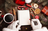 Santa Claus with open notepad
