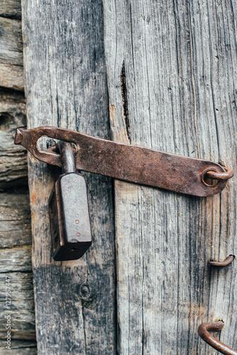 Poster padlock on the old wooden door